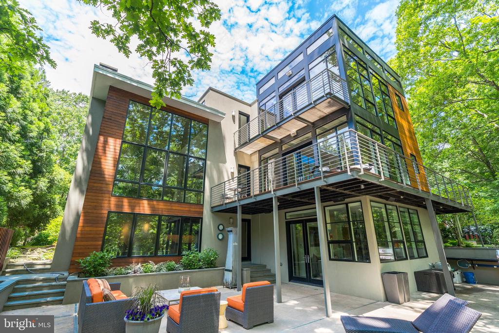 "Breathtaking custom-build, waterfront home by Moore Architects on Lake Barcroft. Multiple design award winner, including ""Best of Year"" by Remodeling Magazine and ""Exceptional Design"" by Fairfax County. Warm contemporary design includes floor-to-ceiling windows with views of Lake Barcroft, high-end updates, upgrades, and features throughout over five distinct levels. Large master bedroom suite with ""treehouse"" views of the lake from your bedroom; separate sitting room, custom closet, large soaking tub and huge walk-in shower. Gourmet kitchen and pantry with high-end appliances including GE Monogram induction cooktop, Advantium microwave, and wall oven; Bosch dishwasher; and Thermador fridge, freezer, and full-height, 2-zone wine refrigerator. Whole house sound / speaker / lighting system, motorized window shades, three fireplaces, and lower level media room with digital projector / surround sound and wet-bar with sink and refrigerator drawers. Backyard oasis positioned above the lake with multiple decks, patio, infinity plunge pool / spa, fountain, and stone walkway to boat dock - perfect for entertaining groups large or small. Additional features include 3-car garage, 2-zone heating and cooling system, heated tile floors, monitored security / fire alarm, and irrigation system. Attention to detail within every inch of the home, focusing on design and love for entertaining!"