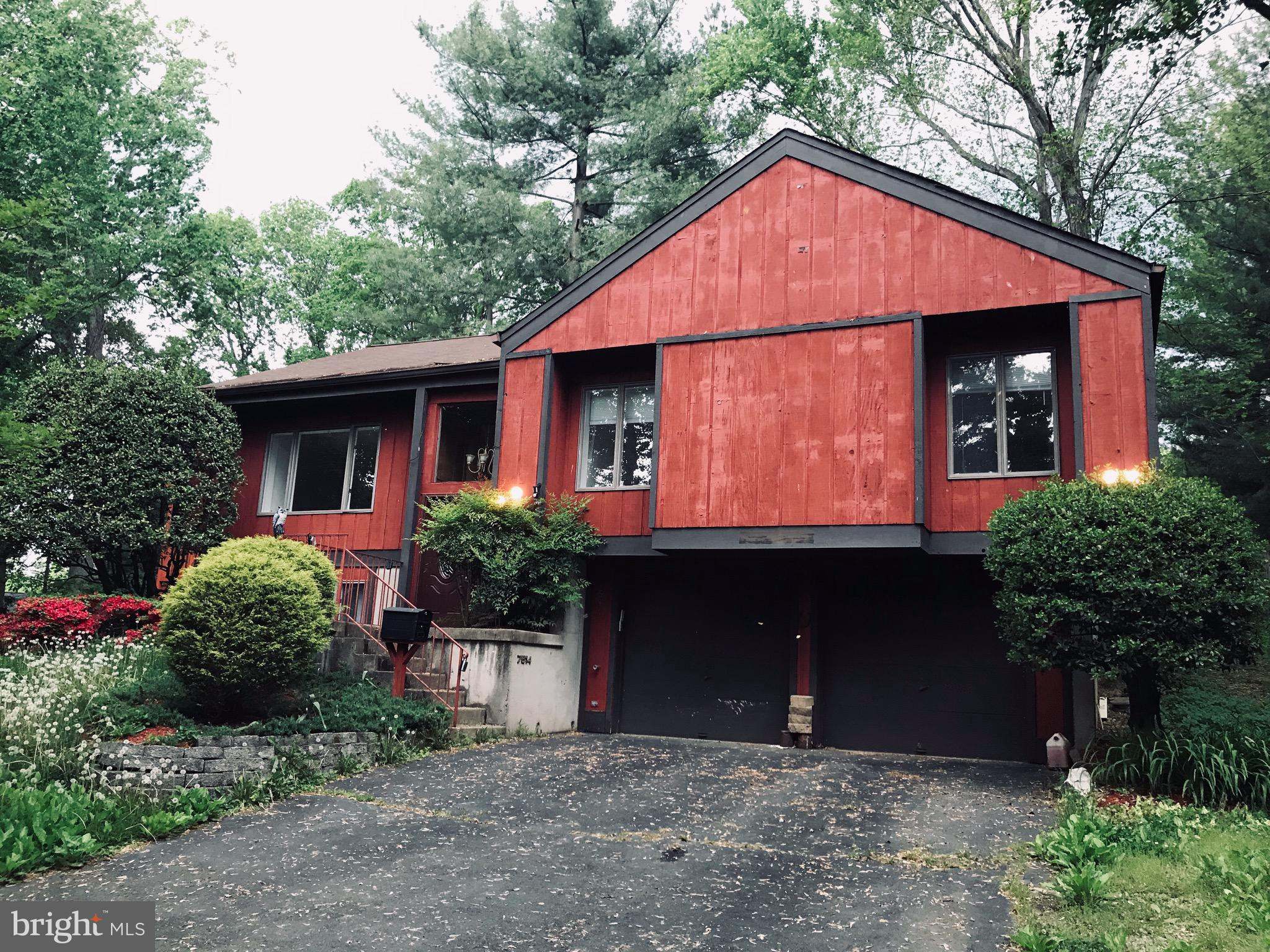 PRICED $57K UNDER 2019 TAX ASSESSED VALUE!! Lovely cabin style home in serene wooded setting, with lots of entertaining space inside and out- large deck with hot tub and nice size yard. Freshly painted inside/out, new lighting fixtures, new floors in the kitchen, basement bathroom and laundry. Vacant and ready for a new owner. MUST SEE!