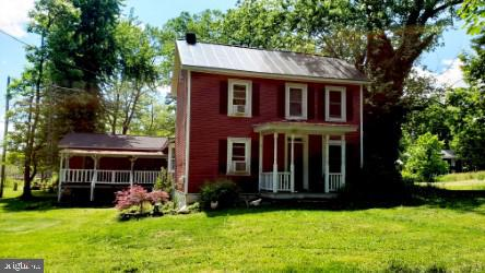 This 4 BD/2 BA country charmer is situated on a little over an acre next to the Duffield's MARC Train Station, perfect for the DC Commuter.  It comes replete with several large, raised bed vegetable gardens, two large storage sheds (one of which is currently an active chicken coup, but could be converted back) and is situated right next to the 2nd oldest standing train station in the country.      This home has three covered porches perfect for outdoor entertaining, modern amenities such as sky lights, a vaulted ceiling in the spacious great room, and a large, useful mudroom/laundry room. There is no HOA, no carpeting, two fire pits (one with a working spit), and both a fireplace and a functional woodstove to make this home a cozy, wonderful getaway from the hustle and bustle of the greater DC area. Imagine relaxing with your wine in a claw foot tub, while listening to the faint sounds of trains as they roll by.  One carport and plenty of off street parking for your guests. Come take a look and see for yourself how this uniquely appointed house could easily charm you.