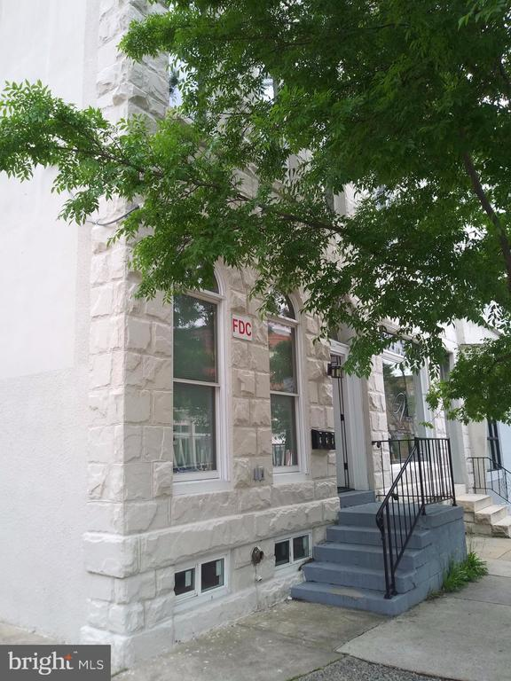Main level apartment. Nice/ Renovated update 2BR 1BA apartment.  Hardwood flooring throughout and updated kitchen.  Washer/Dryer in the unit with large windows for excellent lighting.  Great location next to many Baltimore Shops.  Assigned Parking (1 spot) $35/month if not already occupied.
