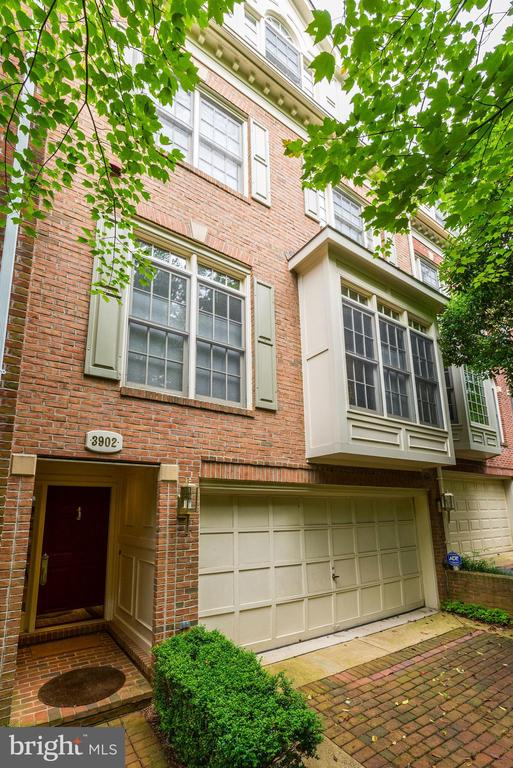 Stunning 2 car garage townhouse.  4 levels including 3 Bedrooms, 3 Full & 2 Half Baths, fireplace, finished lower level with walk-out onto patio. High ceilings, hardwood floors, moldings, deck, & patio. Views from the front and back of house. Private tree lined setting. Gated community including lake,pool & tennis courts and private security
