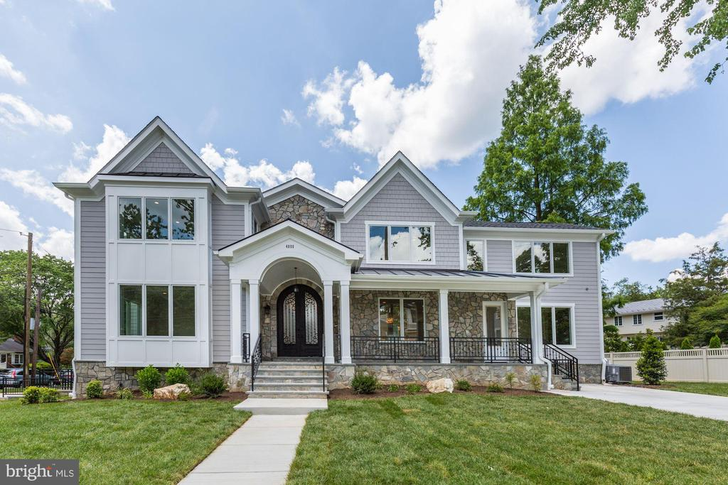 Spectacular architect/builder designed luxury home on oversized corner lot in Westgate in Bethesda!  From the stone porch, enter your palace through the custom double doors to 2 story foyer, highlighted by a designer chandelier that can be electronically lowered for maintenance.  The open contemporary floorplan allows personalization as you customize how you'll use the vast amounts of space.  The main and upper levels boast breathtaking hardwood flooring with the main level offering a bedroom with en suite bath, formal living room, dining room with built-in serving area and mounted wine rack.  The open Kitchen with 6 burner Thermador gas stove and custom island offer ample entertaining space as does the flow into the great room which is highlighted by a floor to ceiling stone walled gas fireplace.  Access to the deck from the breakfast room and a secondary front entrance and powder room complete this level,  The upper level features the same spectacular hardwoods. t\The owner's suite details including a tray ceiling, opulent master bath, dual walk-in closets and second stone walled gas fireplace.  3 additional suites adorn the upper level.  The lower level features 2 additional BR and 2 full baths as well as a family room or future media room and caterer's kitchen.  the final touch is the 2 car side entry garage.  Real estate tax amount reflects prior home. All information deemed reliable but not guaranteed.  All offers to be GCAAR contract with financial information sheets.
