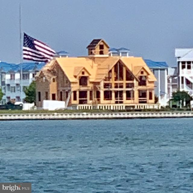 This impressive 6BR/4.5BA home is located in the Estates at Inlet Isle Lane in West Ocean City and has deep water! Enjoy open bay views and endless sunrises and sunsets in this premier location with the famous Ocean City  boardwalk in the background. There is a deep water slip that can accommodate a 42 ft boat providing easy access to the ocean at the inlet. This home is designed and built by David Bradley of Bradley Construction, a respected architectural visionary, having created yet another masterpiece.  The home boasts 4650 sq ft and has an optional bonus room that could be finished to add 2 additional bedrooms and a bath if desired. Once it's gone, it's gone... LOCATION! LOCATION! LOCATION! Imagine that your dream home will be close to world class Marinas, Fishing, Golf Courses, Assateague Island, Ocean City Boardwalk, and Restaurants. Your family and friends are sure to make memories that last a lifetime here. Come take a look at this dream home that has it all including stunning, unmatched architectural style, location and lifestyle! Contracts are being accepted now!  Pick your finishes.