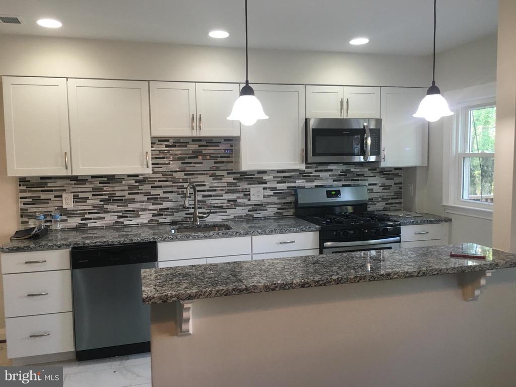 Beautiful renovated 3 B/R 2 Full bath with large finished basement, off street parking, granite counters, stainless steel appliances, custom tile work throughout.  Property is currently under construction  and will be ready for an August move in.