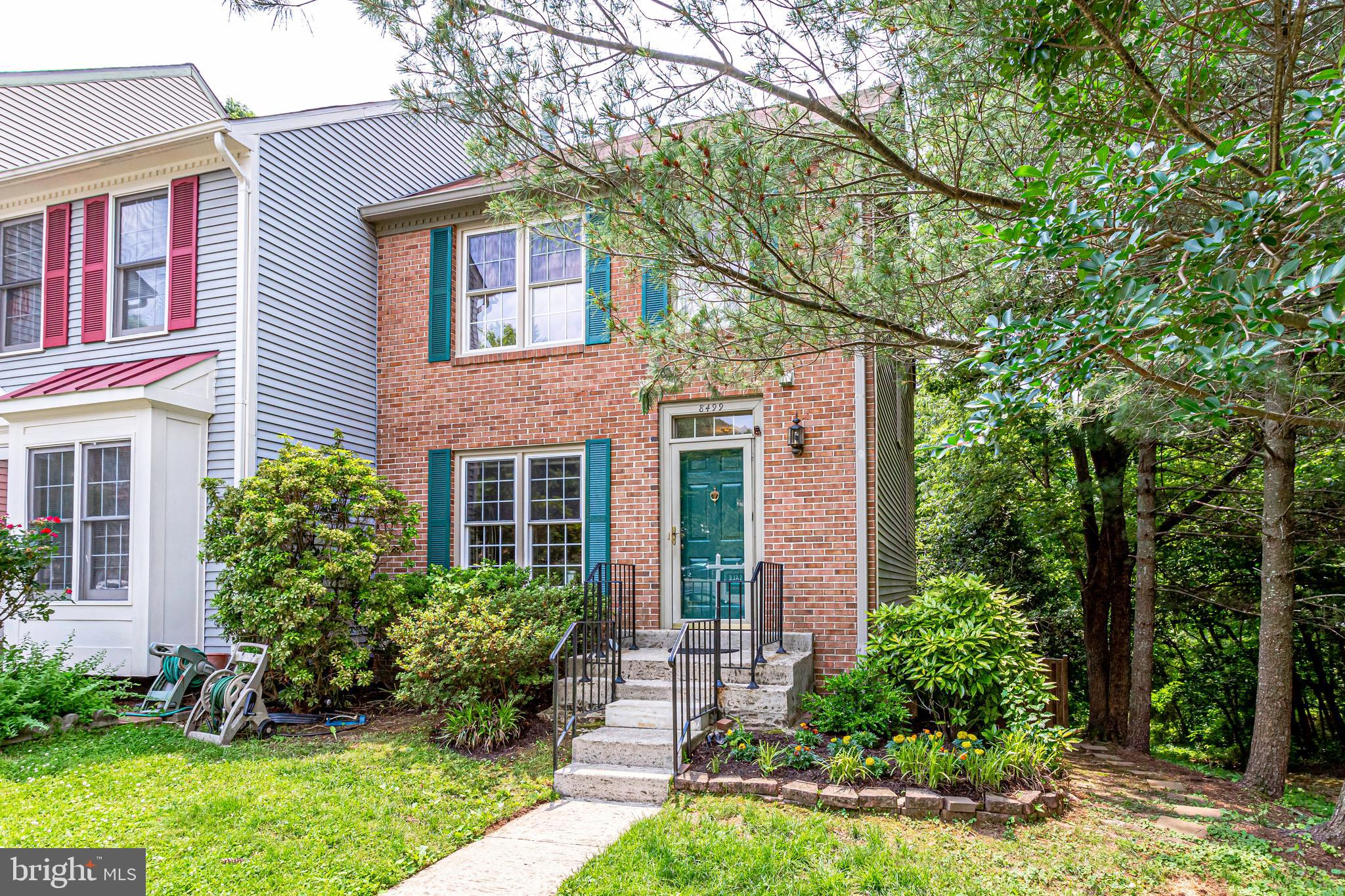 OPEN HOUSE 1-4 PM Sunday, June 9. End unit private townhome with high-end upgrades throughout will make you feel right at home. When you walk in, you see the luxuriously updated kitchen with new white cabinets, desirable quartz countertops, newer stainless appliances and plenty of space for a chef to create a culinary masterpiece. Open concept provides comfortable space flooded with an ample of natural light from the great windows only corner unit can afford. The living room's centerpiece is the wood burning fireplace. Walk onto your private deck to enjoy the view of nature and breathe in air from various trees that surround the property. Main level, staircase, and upper level crown beautiful high-quality hardwood floors. The master bedroom is located upstairs towards the back of the home with its own updated en-suite master bathroom. Tall ceilings and his and her closets make it a grand master bedroom suite. On the other side of the upper level are two additional sun-filled bedrooms with beautifully updated hall bathroom. The lower level is perfect for an extra hang out space, movie night, or practicing your musical talents. The laundry/utility area is fully finished and can serve as extra storage or it is open enough to turn it into a workout room. You will be nicely surprised by the large size of the full bathroom downstairs. The bricked patio is ready for an awesome time with your friends and family. The community offers tennis courts, basketball courts, playgrounds, and plenty of walking paths. The location of this corner townhome is conveniently located close to I-95, Lorton VRE, Fort Belvoir, many parks, restaurants, and shopping centers. Come see for yourself if this house is your new home!