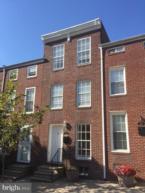 JUST REDUCED!!Renovated and well maintained 3+ level brick home-Conveniently located and easy walking commute to shops,Hopkins,restaurants,& all of the festivities downtown Baltimore has to offer. 4 bedrooms-wood floors-updated kitchen and baths. Large rear parking lot.