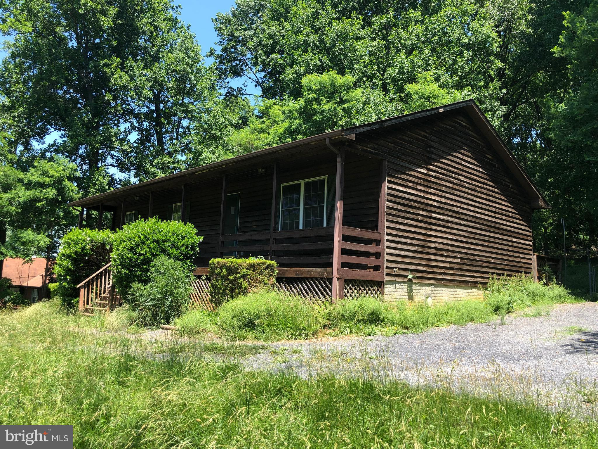 Cedar rambler with full basement features 3 BRs and 2 full baths, 2 car garage with wooded/ mountain views.
