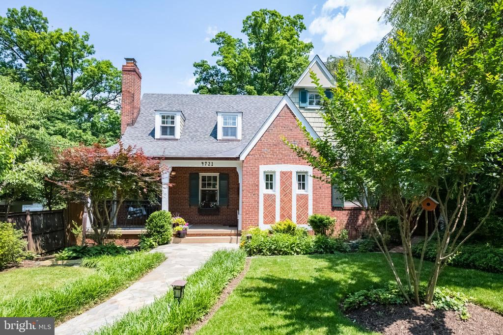 OFFERS DUE ON TUESDAY, 6/11, AT 3PM. A MUST SEE, an oasis in the city! Meticulously maintained 1938 Arts and Crafts style home nestled on a lush lot in the heart of American University Park. The open floor plan and extra large bedrooms are perfectly suited for today's buyer.  This impeccable home showcases many original features throughout: fluted crystal clear hand hammered and brass doorknobs, original chestnut doors, trim and 11- foot mantle - too many details to list! The gourmet kitchen boasts Italian Scavolini cabinets and high-end appliances, a built-in pantry, handmade glass tile back splash and ceramic tile floors.  The kitchen opens to a large dining/living area with original hardwood flooring and a built-in dining hutch with lighted glass cabinets. French doors lead to a four-season sun room with skylights. Two large bedrooms and a full bath complete this level. Upstairs are two generous bedrooms, a large full bath and a bonus unfinished walk-in storage closet with endless possibilities. The lower level offers vast living space, laundry and a fifth bedroom with private entry. Abundant basement storage with four closets and two walk-ins!  The professionally landscaped garden with a fully-fenced rear yard offer an oasis in the city. With alley access, the detached garage offers an electric car charging station and epoxy flooring. This extraordinary home is situated on one of the best blocks in what is arguably the most coveted neighborhood in Washington DC. Enjoy easy access to Tenleytown, Friendship Heights, and the Massachusetts Avenue corridor. Janney, Deal, Wilson, Millie's, Pizzeria Paradiso and more!  Welcome home!