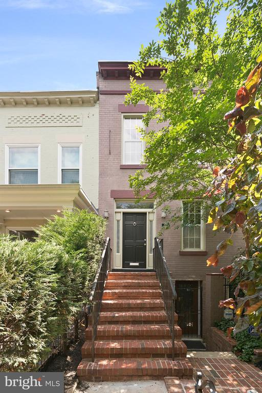 A rare offering located in close-in NoMa and H ST NE! The grand dame of the neighborhood. Semi-detached and expansive 2,910 sq. ft. Federal row home set over three finished levels. Situated on a premier block, this 4 bedroom, 3.5 bathroom home with a successful Air BNB lower level is an opportunity not to miss. Bespoke details include soaring ceilings, recessed lighting, walls of windows, exposed brick, and stunning hardwood floors throughout. The over 20' wide open living room features room to stretch out, and leads into the large dining area to the well appointed kitchen. The chef's kitchen is outfitted with a perfect breakfast bar and a suite of stainless steel top-of-the-line appliances. From the kitchen one can access the private backyard oasis - think dining al-fresco, lounging with friends, and entertaining! Upstairs you will find three spacious bedrooms, each flooded with natural light, and equipped with large closets. Step downstairs to the incredible basement. Configured as a stunning apartment, additional storage spaces, full kitchen, bedroom, and en-suite spa bathroom. The possibilities are endless here. Currently generating roughly $135 a night in Air BNB income, in law suite, au pair suite, and more. Finally, off-street parking truly completes this home. Live in the heart of H ST NE, with the new Whole Foods, Trader Joes, fine dining from Capitol Hill to H ST to Union Market, NoMa Redline Metro, Union Station, and a wonderful social scene right at your doorstep!