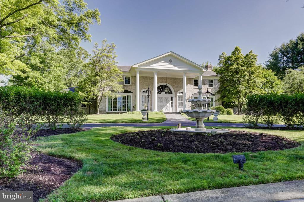 A tree-lined estate drive leads to this elegant Southern Colonial on 9.7 landscaped acres in the heart of Greenspring Valley. 2-story marble Foyer w/dual curved staircase, formal Living Room & Dining Room w/built-in china/serving cabinetry. Large gourmet Kitchen w/breakfast area, adjoining Family Room. Library w/fireplace, wet bar & full Bath. Incredible 1st floor Master Suite w/Master Bath complex w/Spa Bath, additional Bath & custom fitted Dressing Rooms. 2 Bedroom suites on 2nd Level. Heated in-ground Pool, Pool House, covered Porch, Patios & Terraces. One additional density right, subdivision possible.