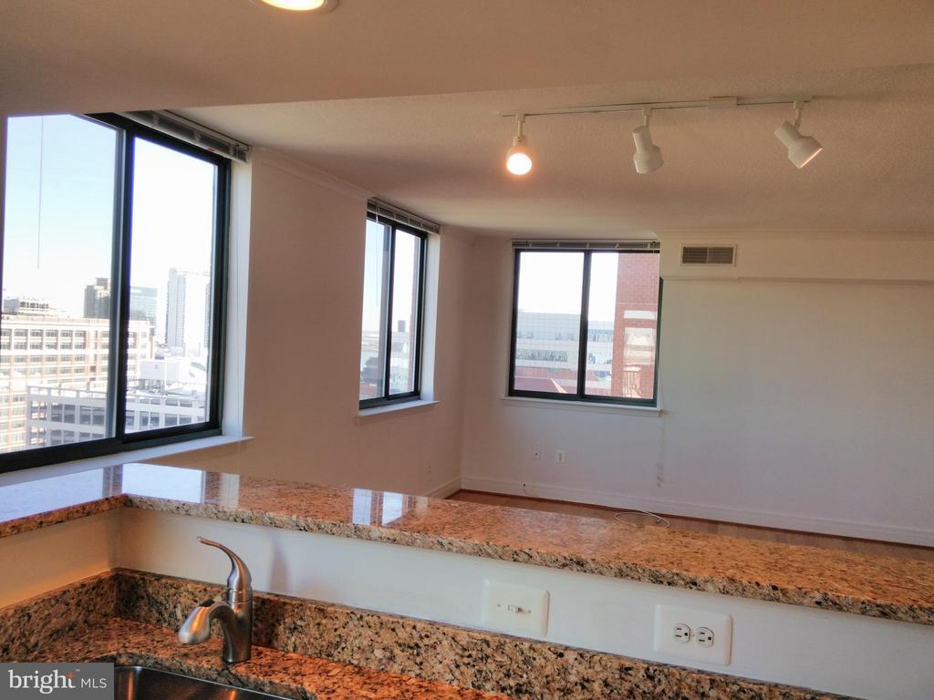 Largest 2 bedroom floor plan with a truly GREAT room for living, dining, entertaining.  Sweeping views from 3 exposures!  Enjoy morning sun, southern light and northern views from the balcony off the kitchen of City Hall, Shot Tower and....Hopkins!  Bedrooms at opposite ends allow for privacy and separation of space.  Master BR suite has both a whirlpool bath and a shower stall.  414 Water Street offers high rise views, luxurious amenities, convenient garage parking within the bldg, and a central location to Harbor East, Federal Hill, UMD , Hopkins and Mt Vernon.