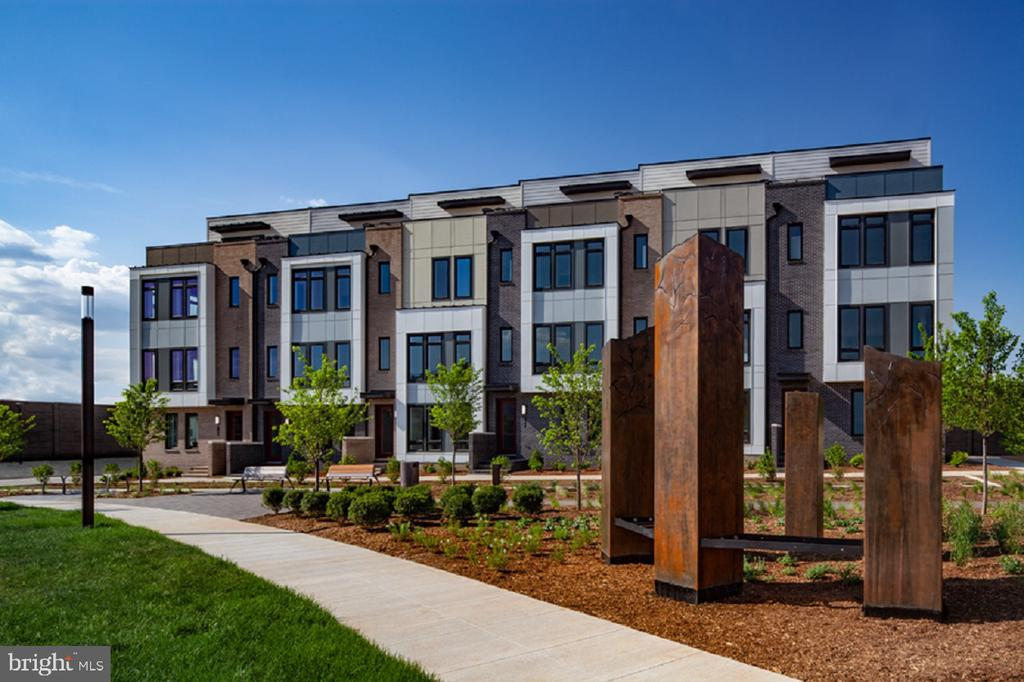 Immediate delivery Harper Contemporary! Unique, sophisticated end unit TH w/ exquisite interior finishes. 4 bedrooms each with private bathroom. Expansive 10~ ceiling on living level, 9~ throughout. TH features open staircases, luxurious master bathroom and scenic rooftop retreats with Western door. ESQ offers a ~ acre central park w/ artwork and benches. Located moments to Old Town Alexandria, easy access to major commuting routes and minutes into DC. Walk to Metro, shops, entertaining and dining. Move in Summer 2019.