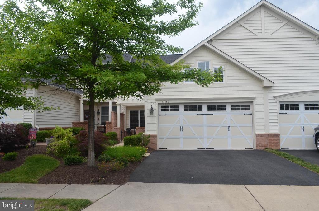 Huge Price Drop!  Beautiful and well taken care of Regency II Villa in gated Potomac Green.  Open floor plan, updated Kitchen with new quartz counter-tops, Master suite on main level. New hardwood floors, amenity rich and vibrant 55+ community with pools, tennis courts and more, close to One Loudoun, Dulles, Inova, Shopping/Dining.