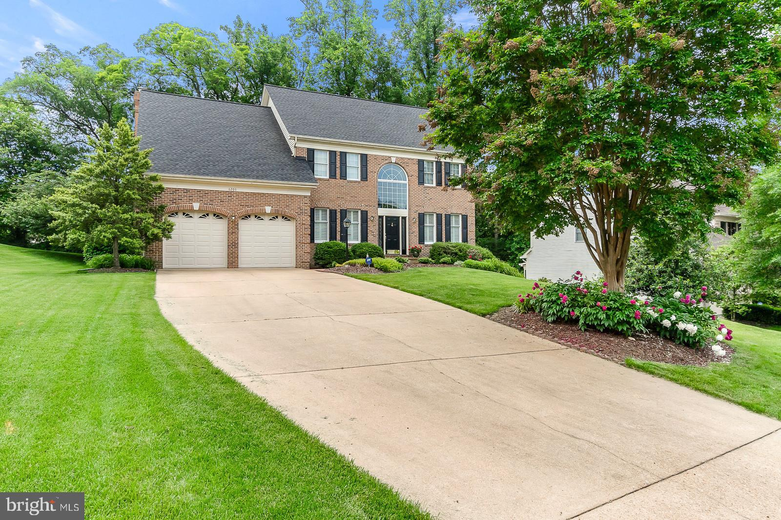 IDEAL BRICK FRONT, 5 BEDROOM COLONIAL ON .43 ACRE LOT THAT BACKS TO TREES.  LONG DRIVEWAY & 2 CAR GARAGE.  SUNROOM IS ALL WINDOWS AND LEADS TO COVERED WOOD DECK.  HUGE, OUTSIZED FAMILY ROOM W/ RAISED BRICK FIREPLACE.  GRANITE GOURMET KITCHEN W/ WIDE BUFFET BAR, SS APPLIANCES, DOUBLE OVEN, BUILT-IN MICROWAVE.  BREAKFAST TABLE AREA.  HARDWOOD FORMAL DINING ROOM, LIVINGROOM AND STUDY.  ELEGANT CROWN MOLDING AND SHADOWBOXING.  TWO STORY FOYER HAS HARDWOOD FLOORS & STAIRS WITH WROUGHT IRON PICKETS AND NEW FRONT DOOR W/ SIDELIGHTS.  SPECTACULAR PALLADIUM WINDOW ABOVE.  SPACIOUS MASTER BEDROOM WITH HALLWAY TO DESIGNER MASTER BATHROOM:  FREESTANDING SOAKING TUB W/ CHANDELIER, QUARTZ COUNTER, BUILT-IN CABINETS, MARBLE FLOORS, GLASS SHOWER ENCLOSURE W/ RAINSHOWER HEAD.  BONUS UNFINISHED ROOM ADJOINS MASTER FOR STORAGE OR FUTURE EXPANSIVE CLOSET SPACE AND SITTING AREA.  HALL BATH ADJOINS GUEST BEDROOM.  SUNLIT WALK-OUT BASEMENT: 7 WINDOWS, HUGE, OPEN AREA, 5TH BEDROOM, FULL BATH, SLIDER LEADS TO WALK-OUT LEVEL PATIO.  LAWN SPRINKLER SYSTEM.  SEE LIST OF UPGRADES.  NEAR PARKS, SHOPPING, TWO METRO STATIONS, MINUTES RTE 395.  COMMUTERS DREAM!!!