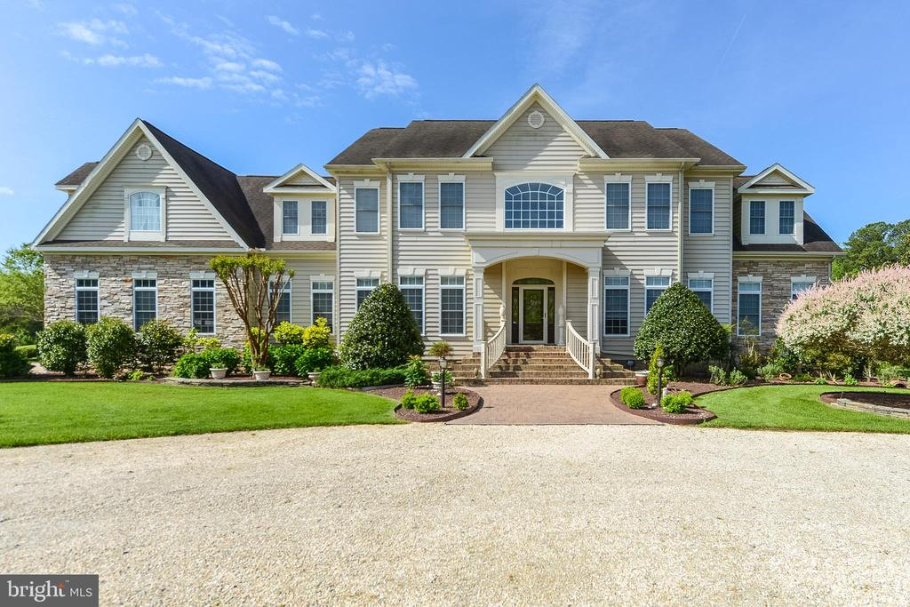 This incredible six-bedroom estate is on seven plus acres with a fabulous pool and magnificent pool house, has privacy but is in a community close to all that Ocean City has to offer!  With work and school being conducted remotely, now's the time to take advantage of this opportunity to own what is, in effect, your own personal high end luxury resort.  You and your family will never want to leave! This estate is in the exclusive neighborhood of Indian Creek on 7.77 magnificent acres with its own private pond, a beautiful oversize salt water pool and luxurious pool house.  This sensational 6332 sq ft home is minutes from Assateague Island and Ocean City in one of the Eastern Shore's finest vacation destinations. The property features exceptional craftsmanship with astute attention to detail. This home is built for family living and has custom finishes inside and a private oasis outside. The home offers 6 bedrooms, 5 full baths and 2 half baths.  Outside there is a huge in ground pool, beautifully landscaped custom paver patio, a gazebo, and a fully finished pool house with its own kitchenette, workout lounge, full bath and a large office or guest suite on the 2nd floor.  The back yard is fully fenced and offers views of the pond. Inside the home you will find a fabulous gourmet kitchen with eat in dining area, a wet bar, wine cooler, a center island and Corian countertops, all of which will surely delight the chef in your family.  Off the kitchen is a spacious great room with a wood burning fireplace for year-round enjoyment and perfect for entertaining family and friends. Not to be missed is the three-season sunroom with screened in porch off the kitchen which overlooks the pool and beautifully landscaped grounds. There is a formal living area and study with fireplace on the first floor as well.  On the second level you will find the luxurious master suite complete with a sitting area and a master bath retreat.  The additional bedrooms and bath are all large in size making this the perfect home for your family.  Additional features in this estate home include: 3 car garage, hardwood floors, custom tile floors, crown moldings, tray ceilings, built-ins, custom cabinetry, hardwood floors, custom window treatments and 4 zone high efficiency heat pump system. There is also custom lighting throughout the home, attic storage, and the list goes on and on. This estate home is 1.5 miles from Ocean City Golf Course, 1.5 miles from the Public Boat Ramp, 2.4 miles from Rum Point Golf Course, 6 miles from Assateague Beach, 8.5 miles from Ocean City Airport, 9.4 miles from Sunset Marina and 10.5 miles from the Ocean City Boardwalk. Your family and friends are sure to make memories that last a lifetime here.  Come see for yourself.  Schedule you're showing today and consider making this dream home yours!