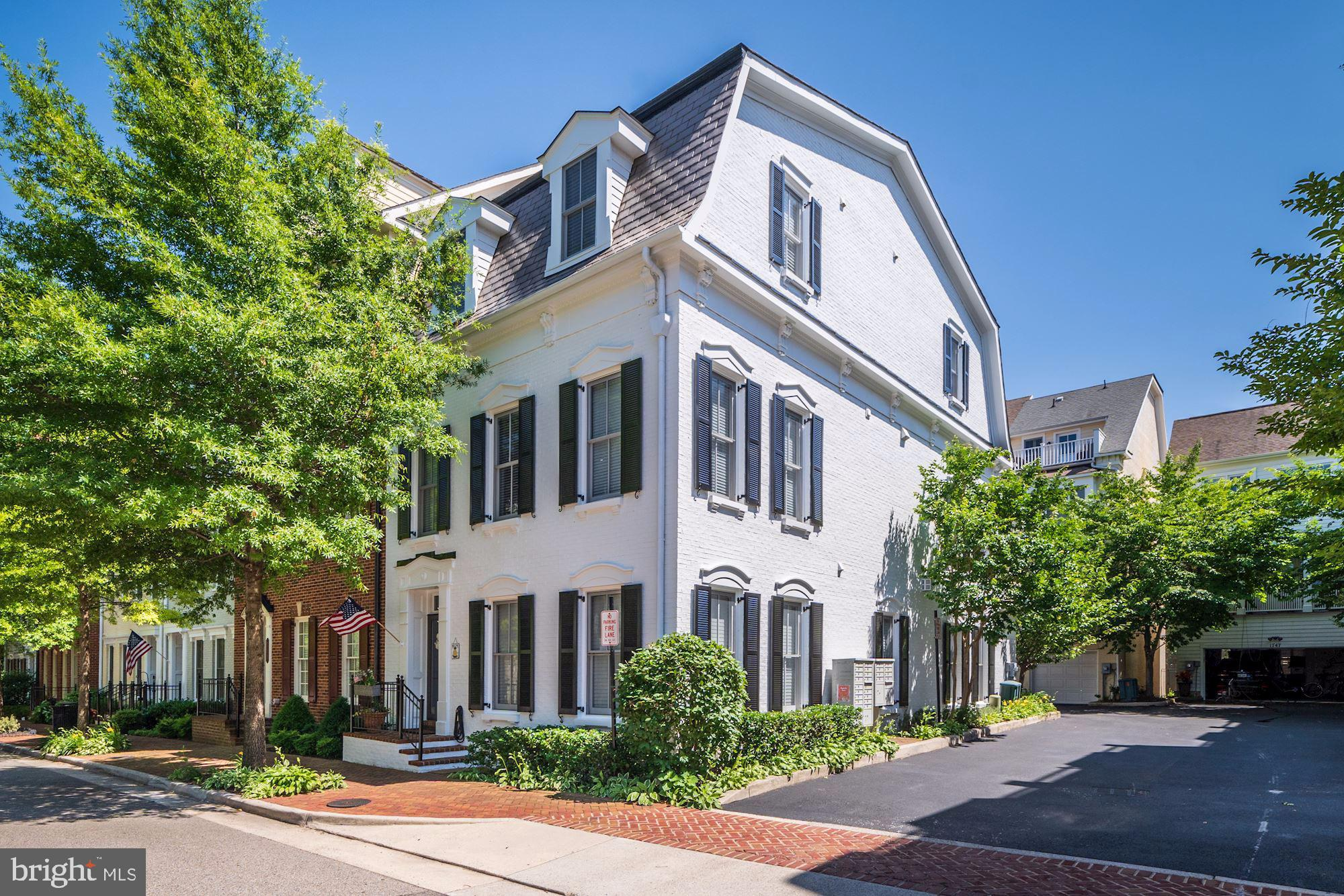 Rarely available Jackson Model 3-level, sun-drenched, end townhome in sought after Potomac Greens!  Located between the heart of Old Town Alexandria and Amazon HQ2 at National Landing!  This gorgeous brick, meticulously maintained home has 4 bedrooms, 3.5 bathrooms, and a spacious den with custom built-ins.  This beautiful 3,082 SF home, is fabulous for entertaining, boasts a great layout, tons of windows, brand new carpet in the first floor bedroom and den, gleaming hardwoods, custom built-ins in the family room, custom closet systems in both Master Bedroom closets, complete roof replacement in 2019, freshly painted inside and out, SunSetter awning on large deck-terrace off of the kitchen and family rooms. Two gas fireplaces.  Spacious two car garage with GarageTech work bench and cabinets. Community pool, gym, and party room with low HOA fees.  There are only 7 Jackson Models in Potomac Greens.  It is the most functional floorpan in the community. This home won't last long!