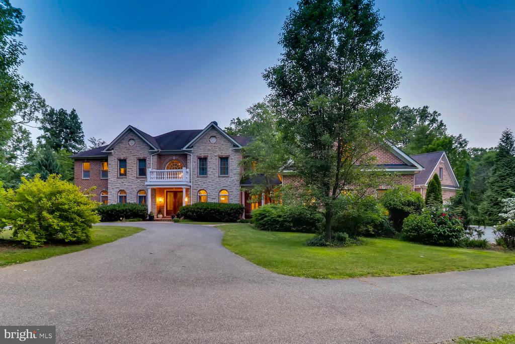 """HUGE price reduction and opportunity of a lifetime! This is THE Last Chance to make this home your own! Beyond a stately iron gate, you will find yourself in an exceptional  custom built home situated on over 28 acres of nature's magnificence. Enjoy the woodlands and the streams on your very own property, or retreat into your new home where you can entertain or unwind. From the small architectural details to the thoughtfully laid out floor plan, this home will amaze you!Imagine a 2 Story grand foyer with a sweeping staircase, elegant formal dining and living rooms, main level office with french doors, an expansive sun room and a gourmet chefs kitchen with an oversized granite island complimented by SubZero and Bosch appliances.  Methodically built allowing every space to experience spectacular views of the stunning grounds and incredible sunsets. Multiple decks and patios made perfect for entertaining and lounging. Enter the top level where you will find 4 generously sized bedrooms with 4 full bathrooms and an oversized master suite complimented by a private deck and a massive walk-in closet built for the stars! True guest suite located on main level with private stair. Continue to enjoy the home's amenities in the fully-finished walk out basement where you can work out in your private gym, kick back in the theatre, enjoy a beverage from your temperature-controlled wine room, or walk out to your heated pool equipped with a water slide! When you want to have it all, this is the home for you. Located in the Hereford Zone! Your private oasis awaits! Short Sale-Home Sold """"As Is"""" but in excellent condition!"""