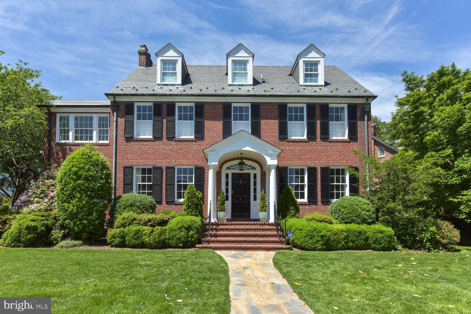Gracious 5 bed, 4.5 bath 1930s brick colonial w/detached 2-car garage in picturesque Belle Haven. History meets levity: stately architecture balanced by sunny windows, skylights & shimmering French doors. Grand 9-foot ceilings & HW floors thru-out. Elegant wainscoting & moldings. Contemporary updates include custom built-ins, apothecary-style master bath & magazine-worthy kitchen. Formal dining, cozy living & private work/play spaces. Organization galore in the mudroom, finished basement, ample closets. Spacious kitchen w/eat-in window banquette, island w/range & seating, immaculate white cabinetry. Outdoor entertaining simplified by the bricked patio, manicured lawn.