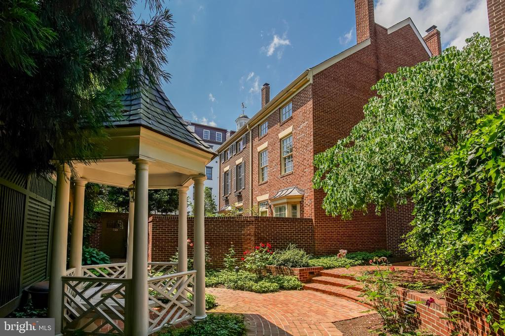 Rarely available two bedroom, two bath townhouse in the sought-after North Old Town community of Shad Row.  Shad Row offers modern convenience and historic flair: overlooking the historic  Robert E. Lee Boyhood Home, 548 North Saint Asaph is located five blocks from King Street, walking distance to Braddock Metro, a block from Trader Joes, and two blocks to Harris Teeter. This four-level, end-unit townhome offers it all:  reserved garage parking, a new kitchen, updated baths, refinished oak-floors, highspeed cable wiring, south-facing windows and skylights, a charming brick patio, a new HVAC system, a working fireplace, a full basement with a work bench and utility sink, and an enormous attic space for additional storage. Low condo fees ($350 per month) include water, exterior maintenance, bike room, landscaping, and garage.