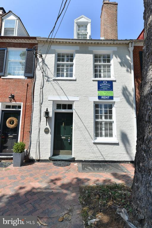 Remarkable for its style and ease of living, this handsome,  antique townhouse will surprise you with its space and charm.  Offering the perfect blend of old and new, the original floors, tall ceilings and attractive millwork highlight the well deigned living spaces.  Of special note are the main level kitchen and family room areas. Top notch kitchen, with high end appliances and finishes will suit serious cooks and lovers of carryout. The adjoining family room features a gas fireplace, built-in bookcases and a bank of windows and doors opening to an elegant walled garden.  There are four upper level bedrooms, including a must-see owner's suite with dressing area and en-suite bath.  The daylight basement includes a bath, and recreation room. There are tasteful plantation shutters throughout. Upper and lower level laundry stations. There is not a better location in Old Town.  Please note, this house is much larger than it appears from the street.