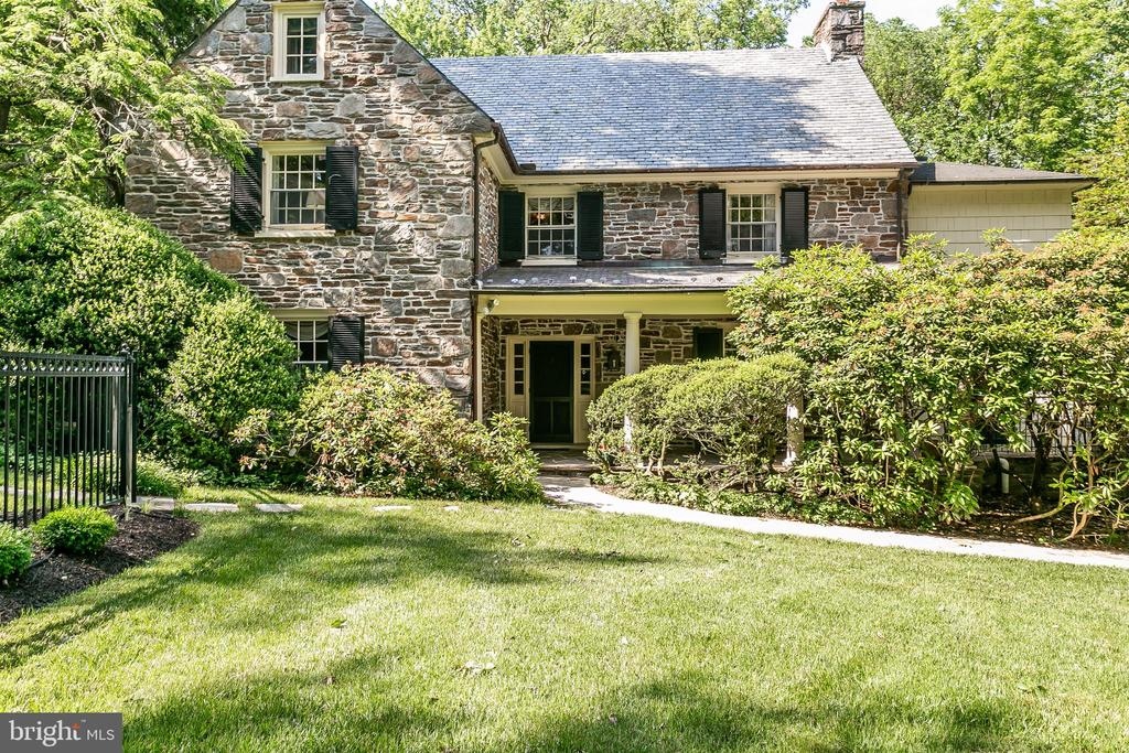 New Price - This Charming, English-Style, Stone Country Home, offers traditional Old-World Craftsmanship.  Situated on 2.59 acres,  in one of Baltimore County's most desirable locations, this home offers the following:   Lovely Covered Front Porch, Formal Living Room, Gracious Dining Room, Butler's Pantry.   Sun Room with sliding doors to access Stone Terrace,  Great Family Room addition added in 1985 with high beamed Cathedral ceilings, Palladian Windows, extra-large fireplace and extensive Built-ins.    Bonus room off of the Family room could be used as a first floor study, or spare bedroom.   The second floor includes the Master Bedroom with full bath and dressing room, plus two additional bedrooms that share a buddy bath.    An Artist's loft overlooks the family room below.   Third level offers two bedrooms plus another full bath. Lower level has a club room with a fireplace.  An attached two-car garage can be accessed from the rear of the house.  Mature landscaping and an irrigation system help keep the property private and lush.