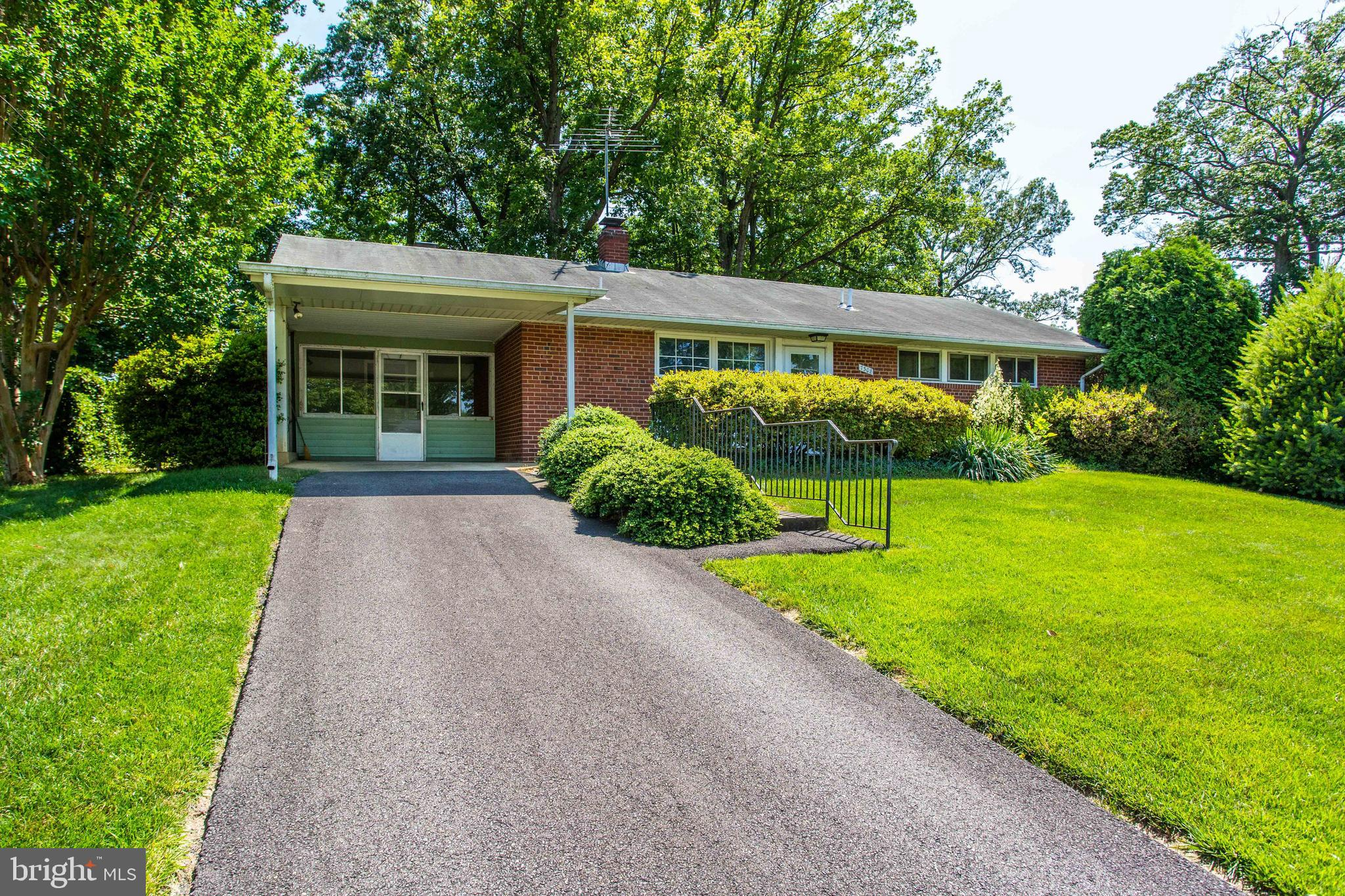 Amazing opportunity on 0.24 Acres of natures beauty! This charming Ranch/rambler offers 3 Bedrooms, 1.5 Baths and endless options for any lifestyle. A spacious floor plan greets you as you enter the sun-filled family room with dual-sided brick fireplace, built-ins and glass sliders to the covered patio overlooking the beautiful grounds. Offering warmth to both the Family room and Kitchen, this brick fireplace is the perfect option for some extra heat in the colder weather! The Kitchen features ample cabinetry and a perfect eating area with double windows to let the sun stream in. Easily flow from the Kitchen into the sun porch with a wall of windows and access to the patio.  A bonus room connected to the laundry room is just waiting for you to make it your own! Located in a prime Springfield neighborhood, this home is just minutes to major commuter highways, Franconia-Springfield Metro/VRE Station, Town Center, and more!