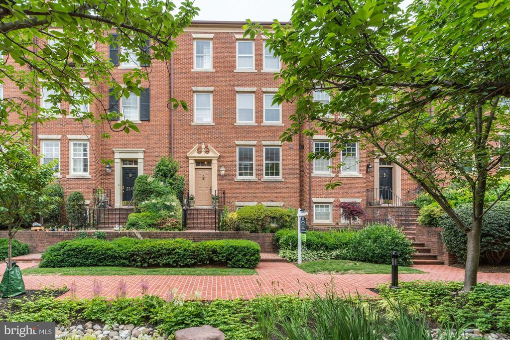 Impeccably maintained and gently lived in for many years. Four story Cloisters West townhome with elevator.  First floor features updated eat-in kitchen with granite counters, dining room and step down LR with fireplace and large windows for great light,  Each bedroom has its own bathroom- four bedrooms and four bathrooms on upper 2 levels; lower level has a 5th bedroom/office with a full bath, family room with second fireplace and wet bar, several storage closets and large utility room with washer and dryer. French doors lead from the family room to a fenced private patio and garage plus one additional parking space.   Amazing price allows buyer to update to their specifications. (Recent updates include fresh paint, refinished wood floors on three levels and new microwave). Almost 3500sf. Walk to all Georgetown amenities, bus at corner. New heat pump, compressor and thermostat on upper levels.
