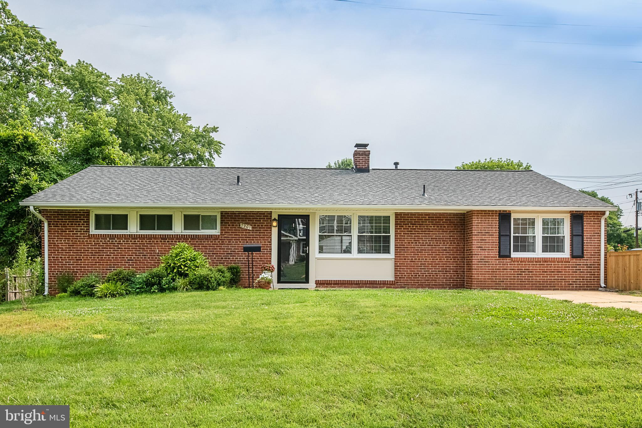 No HOA! Corner lot with a private driveway nestled in Springfield; brand new roof and gutters. 2 parks nearby! Brookfield Park and Lake Accotink Park feature activities such as kayak rentals, trails, mini golf, and so much more! Beautiful and modern kitchen features brand new stainless steel appliances, granite countertops, and a custom backsplash. Meal prepping just got easier !Sunny dining room off kitchen with designer lighting. Eye-catching wood-burning fireplace with white brick surrounding in the bright living room; living room has built-in shelving and leads to incredible, spacious backyard with brand new fence, large patio, and landscaping. Open layout wonderful for hosting. Enter the relaxing master bedroom that features a white brick statement wall and you~ll find a huge walk-in closet and luxurious attached bath with a walk-in shower complete with stunning tile. Laundry room is off the master bath and boasts a sink, backyard access, and a brand new stacked washer and dryer.