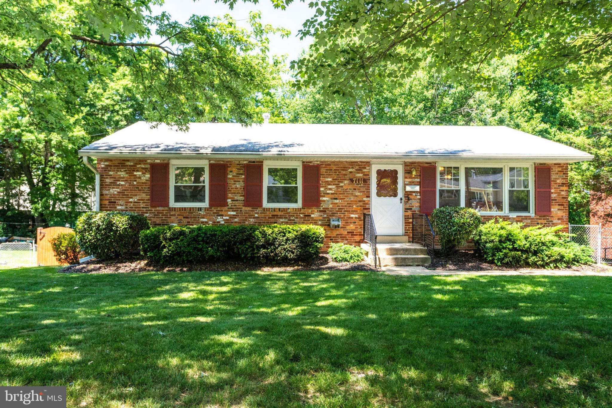 Welcome to 7111 Layton Drive. This charming brick rambler features a large in-ground swimming pool and is located walking distance to Springfield Town Center!