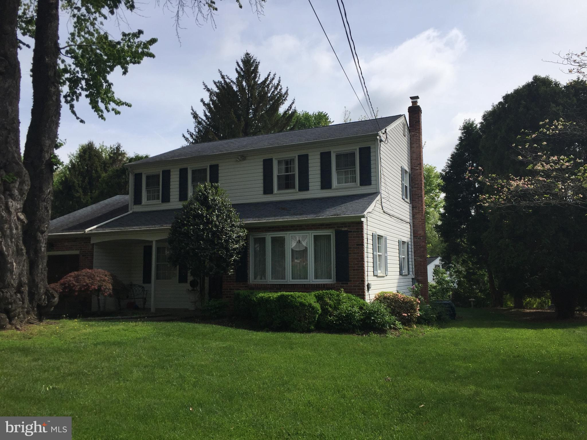 Great Brick & Vinyl sided Colonial with newer Kitchen, & Baths. 3 Bedrooms, 2.5 Baths, Garage, Awning covered Rear Deck overlooking nice backyard. Front covered Porch, Marble floored Entry Foyer, Bright and spacious Living Room w/bay window, Dining Room w/ hardwood floors & chair rail, Newer Kitchen w/ granite counters, C/tile flooring & backsplash, b/i micro, electric cooktop, double wall oven, recessed lights adjoining sunny Breakfast Room  w/ C/Tile floor, bay window & large Laundry closet w/ washtub, Powder Room, Step down to Family Room w/ brick fireplace (gas), hardwood floors & door to large Rear Deck w/ awning. UPPER LEVEL: Large Master Bedroom w/ hardwood floors, c/fan, walk in closet, Newer C/Tile Master Bathroom w/ vanity, shower & heat lamp, 2 Additional Nice size Bedrooms w/ hardwood floors & double closets, Newer C/Tile Hall Bath w/ whirlpool tub/shower, granite topped vanity. BASEMENT has play/game room , plus Cedar closet, storage and utilities. Replacement Windows, Weil McLain Gas Boiler, Central Air, Roof & Siding (approx 2011), Composite Deck (approx 2014), 200 amp CB, 1 car Garage w/ opener. Close to Twp Park, shopping & transportation including regional rail stop. Award winning Springfield Schools.