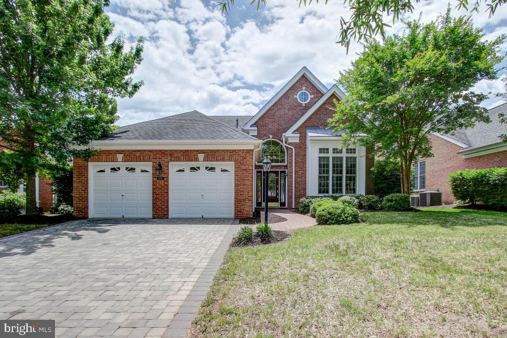 """Beautiful San Remo Extended Model with 2 Main Floor Bedrooms with Full Baths and Study.  Upper Level Bedroom, Bath and Loft.  New Carpet in Main Floor Bedrooms. 10 Ft Ceilings, Crown Molding and Chair Rail, Upgraded Cherry 42"""" Cabinets in Generous Chef's Kitchen!  New Lighting Throughout.  Luxurious Master Suite with Sitting Room and Spa-Like Master Bath, with Jetted Tub, Separate Shower, Double Vanity and Walk In Closet.  Second Bedroom is perfect for TV den or craft room.  Upper Level Loft is ideal for Guests!  Living Room Opens to Patio and Rear Yard.  Less than 1 Block walk to Shopping and Dining through Private Gated walkway.  Walking Distance to Clubhouse and Pools and Fitness Center. HOA fee of 335 includes the social membership that gives you ability to golf (but greens fee are additional) Memberships can be upgraded to Golf Membership more information is at the house and the clubhouse.Indoor and Outdoor Pools, Fitness Center, Pub, Dining Room, Exercise Room, Craft Room, Ballroom, Tennis and Walking Paths... truly resort style living."""