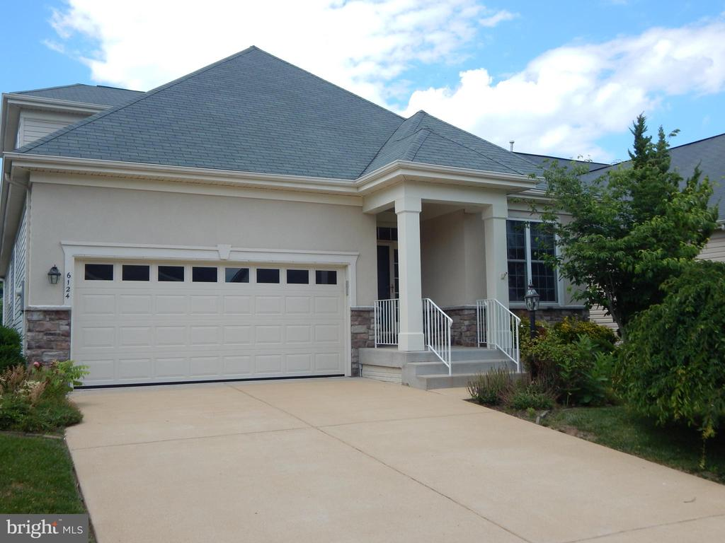 Move In Condition. Freshly painted in  soft neutral greys. New carpet! Main level hardwood floors except bedrooms. Spacious 3 level home.  Open loft over living room. Upgraded thru out. Large unfinished basement with w/o. Cul-de-sac location.  A new roof will be added soon! A new upgraded garage door just installed.  Radon remediation system just installed.