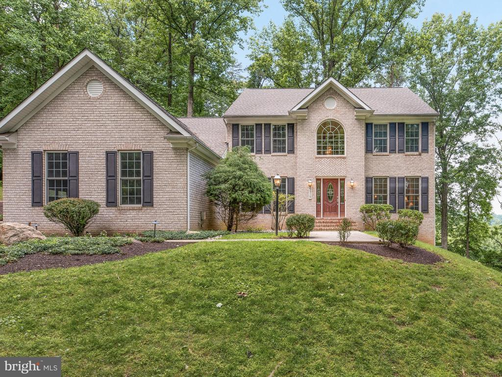 This gorgeous brick home offers 5,000 sqft  on a private 1-acre lot surrounded by nature and beautiful views of Patapsco State Park. Easy access to I-70, shopping, restaurants and Howard Co. schools.  New roof, new A/C, new washer, new gas FP, new carpet and fresh paint.  Light-filled 2-story foyer and a flowing floor plan with spacious bedrooms make this home a must see.