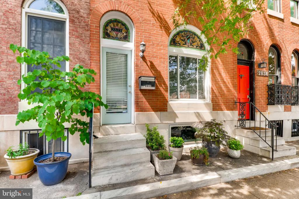 This huge park-front rowhome is brimming with quintessential charm! Many elegant historic details remain in the 4-bedroom, 2.5-bathroom stunner, including gorgeous stained glass windows, molding, gleaming hardwoods & a master suite with a beautiful black-and-white tiled bathroom. Modern touches, like granite counters in the updated kitchen, give this home a flawless finish. Additional updates include chimney flute, new HWH, updated AC & duct system, remodeled patio & remodeled half bath on 1st floor. This home is Baltimore living at it's finest!