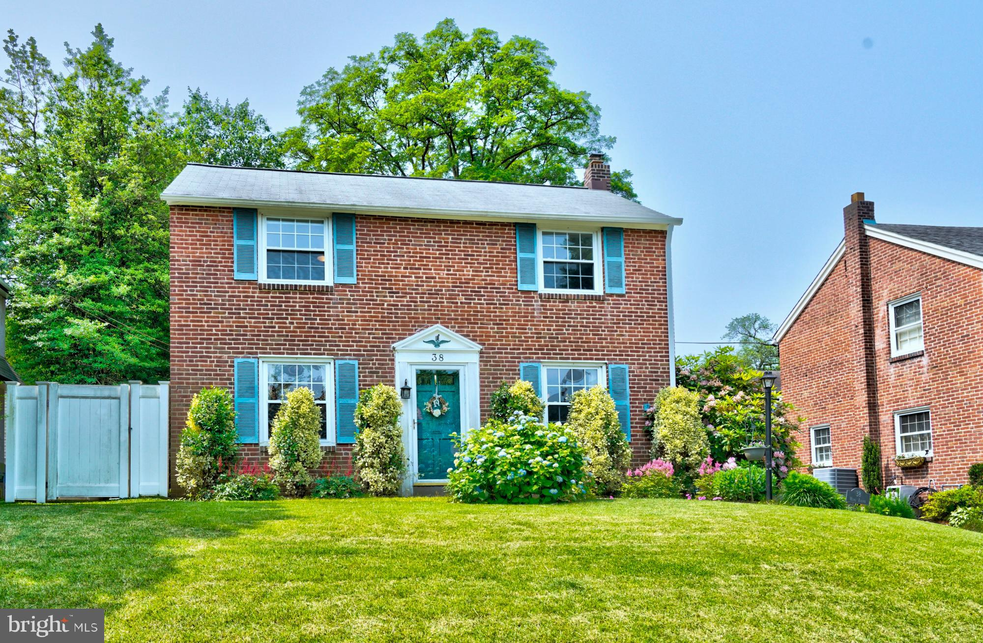Beautiful 4 bedroom 1 ~ bath brick Colonial is waiting for your family.  Enter to a large sunshine lit Living Room with H/W floors and ceiling trim. Formal Dining room has beautiful ceiling trim and chair rail and continues with the well-kept H/W flooring. The cozy kitchen has tile floors and nice cabinet space.  Next to the Kitchen is the breakfast nook with open counter space that overlooks the Family room. The propane brick fireplace will make your winter nights cozy and warm. Powder room is located next to the kitchen along with an access door to the back yard and one access door to the shared driveway. The photos speak for themselves with a full tiled hall bath and 4 nice size bedrooms with nice closet space. The size of the Master Bedroom w/carpets is larger than most in that style house as the previous owners extended the back of the house for added space.  3 bedrooms have H/W floors and the attic has pulled down stairs with plenty of storage. On the lower level a finished basement with a pool table and accessories that are included in the sale price, recessed lighting, laundry room and utility room and more storage. The access door from the Breakfast nook leads to a beautiful brick patio to enjoy outside summer fun and a nice rear yard. Mature plantings adorn the front and back of the house with a partial fenced in yard. The Shed is situated at the end of the shared driveway. Central air finishes off this beautiful house.  Located in walking distance to Septa Trolley lines, shopping and local eateries.   Included; Washer, Dryer, Refrigerator, Pool Table with accessories.