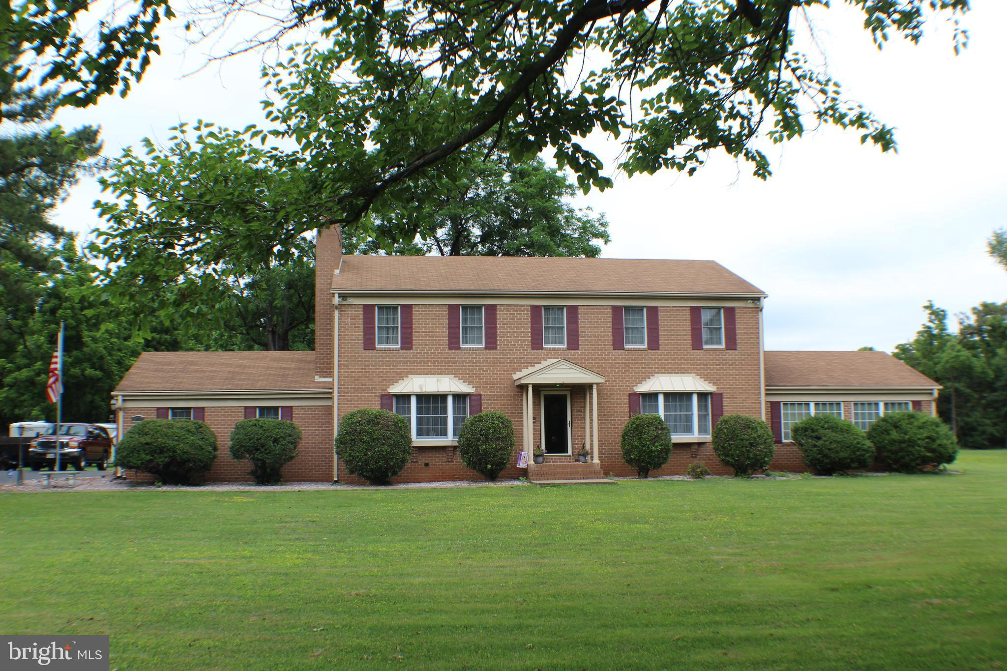 Huge Price Reduction!  Seller is serious. Come see this Fabulous, one of a kind must see home! Come relax and enjoy this beautiful home. You will notice the meticulously maintained exterior, from the home to the lawn and landscaping. This warm and inviting home feels like you're, in the country, but you are actually close to I95, VRE, and John Beach Marina and Yacht Club.  This beautiful all brick home features gleaming hardwood floors and large family room addition, for entertaining, The upper level features 4 Bedrooms and 2 Baths.  The Master Suite includes a wood fireplace! Main level includes Country Kitchen with eat in area, Living Room, Formal Dining Room, and Sitting Room.  Head downstairs to a large recreation room and storage area, with many possibilities. Do you like to entertain?  How about a gazebo that once graced the Mamie Davis Park in historic Occoquan (see pictures).  There is plenty of space with 2 gazebos, patio and huge backyard for entertaining. 5 Sheds (2 with electricity), Andersen Windows and much more.