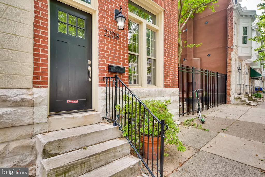 Fabulous light-filled 4 level brick end unit in Station North next to locked private community garden and Calvert Street Park. Recently renovated with three bedrooms (could easily be four) and two and a half baths. Enjoy tall ceilings (9~7~ on the main level), open layout, gourmet kitchen, granite counters with large island, second level family room and laundry, hardwoods throughout, and newer roof (2016)  and AC. Stylish is an understatement on this beauty. Amenities abound, as do local independent businesses --Faddensonnen, Sophomore Coffee, and soon to open Dutch Courage.