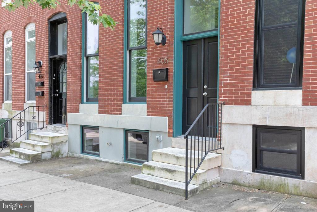 One of the largest town homes in Greenmount West with a full third floor and a full height basement with walk out rear entry. Basement could easily be converted to a one bedroom apartment with private rear entrance. Plans attached as documents. Two car parking pad in rear plus fenced yard and deck overlooking Barclay Park.   Inside the first floor is open concept and includes a half bath. Second floor has two bedrooms, a laundry area and a full bath. Third floor features an open den area, full bath and large master suite with walk in closet.  Several years of CHAP tax credit remain. Save thousands a year on property taxes!!