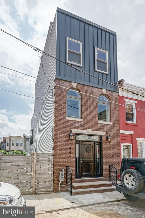 446 Miller St: newly renovated (june 2019) row-home located on a charming street in Fishtown,  America's hottest neighborhood according to Forbes! Well appointed throughout, this home was taken down to the studs and EVERYTHING was replaced and updated. Offering the best of both worlds, sophisticated character along with luxurious modern comforts-this 3 bed 2.5 bath home boasts new electric, Hvac and plumbing throughout. Curb appeal for days, you'll first notice the strong original brick and slate grey vinyl capping off the new addition. The original dark mahogany front door invites you to an expansive living area featuring bamboo flooring and tasteful color palettes leading into an open kitchen boasting stainless steel matching appliances, white shaker cabinets, granite counter tops and stunning tiled backsplash . Head upstairs via an impressive floating staircase to the second floor with two, well sized bedrooms (14x12 and 13x12) with large closets in each and a Juliet Balcony off one room. Make your way up yet another set of floating steps to a master suite, walk in closet and master bath. Exit the rear door to find a small (12x6) rooftop deck perfect for a wetbar or grill, additional steps lead to ANOTHER rooftop deck offering some of the best views the city has to offer! An ample back yard and a finished basement make this Fishtown gem with a 10 YEAR TAX ABATEMENT a must see.