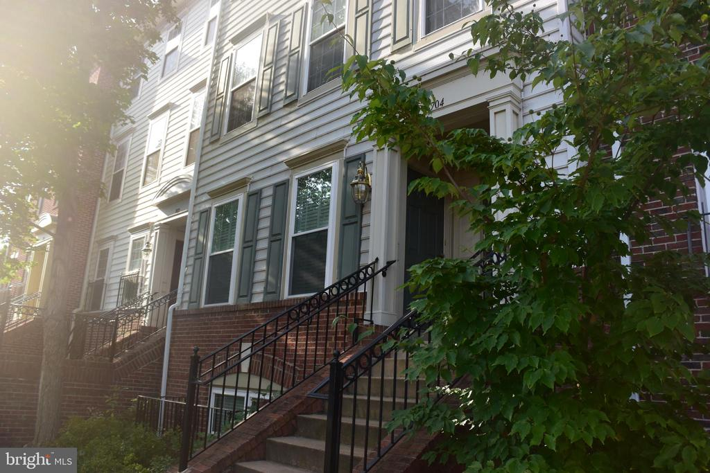 Have it all in this attractive townhouse. Light filled, upgraded kitchen with large eating space, opens to deck. Hardwood floors, full sized washer and dryer. Garage. Easy street parking, walk to shops, restaurants, close in location. Minutes to National Airport. Very popular Old Town Greens. Near historic Old Town Alexandria and Delray. Community pool, with outside picnic tables.