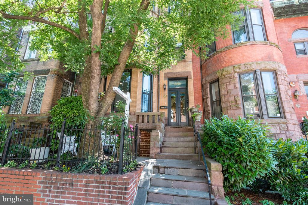 Located a few blocks from bustling Dupont Circle, enjoy this pristine, expanded and updated, light-filled 2-unit retreat. This bayfront Victorian features 3650 square feet on four levels. A charming front garden welcomes you to the historic home. The spacious basement-level apartment has two entrances, 1 bedroom and full bath, an updated kitchen, and its own washer/dryer and is rented at $1950/mo. As you enter the main home, you are greeted with 9~ ceilings and original hardwood floors, a foyer with coat closet which flows into a gallery space. The formal living room features detailed moldings, large bay windows, and a fireplace.  Original functioning pocket doors can separate the formal dining room, which also includes a fireplace and a powder room. The kitchen addition features new stainless steel appliances, including a gas range, granite countertops, white kitchen cabinets, and skylights.  Upstairs on the second level are 2 large bedrooms, 3 closets, 1 full bath with a washer and dryer, and a lovely screened porch. The third level features new skylights, 2 bedrooms, 3 closets, and a room-sized full bath.  C of O for basement unit in process. Dual zone HVAC, brand new roof, and secured nearby garage parking. Zoned RA-8 for residential apartment buildings. Don~t miss the opportunity to call this gracious home your own!