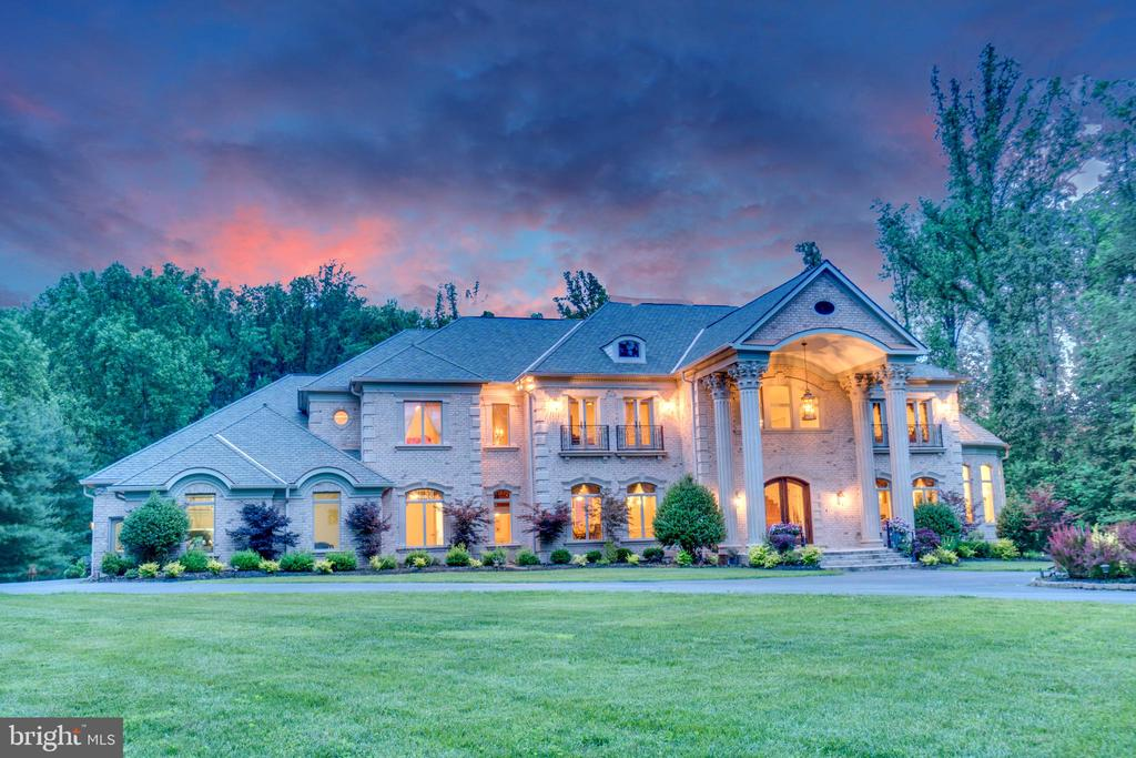 This breathtaking 2009 GALA award winning estate is one of Great Falls~ crown jewels. It sits on an expansive 2.3 private acres and boasts an incredible 14,000+ SF floor plan. Exuding a sense of artistry, style, and craftsmanship, no expense or detail was spared when selecting and building the magnificent finishes for this home. Upgrades and features such as inlaid marble and wood floorings, hand-crafted coffered ceilings, rounded walls of windows, grand dual staircases, wrought iron rails, and detailed moldings can be found throughout the home. Other functional features include 4 different A/C zones, a kitchenette, an elevator shaft, two luxurious steam showers, and a huge deck for outside entertainment. You don~t want to miss out on this absolute gem!