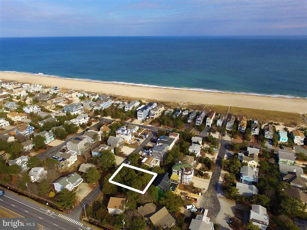 Build your dream beach home on an Ocean Block property in the sought after community of Ocean Village!  Just 5 lots from the Oceanfront, this large 75ft x 90ft parcel will accommodate a spaciously designed residence just steps from the wide, private life-guarded beach.  Rarely are building opportunities available in this ideal location within North Bethany where you can easily bike or walk to downtown Bethany Beach.