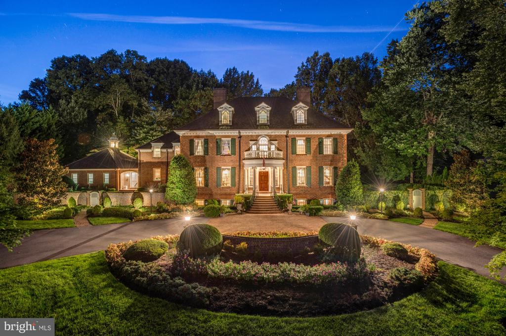 This is one of the only custom designed and built homes on Country Club Drive.  It's 30% larger than most, with a beautiful center gallery and 3rd floor.  The custom millwork, finishes, Flemish bond brick design, newly renovated interior, European gardens, flat/private backyard and exquisite architectural detail truly set it apart.  Must see to appreciate.