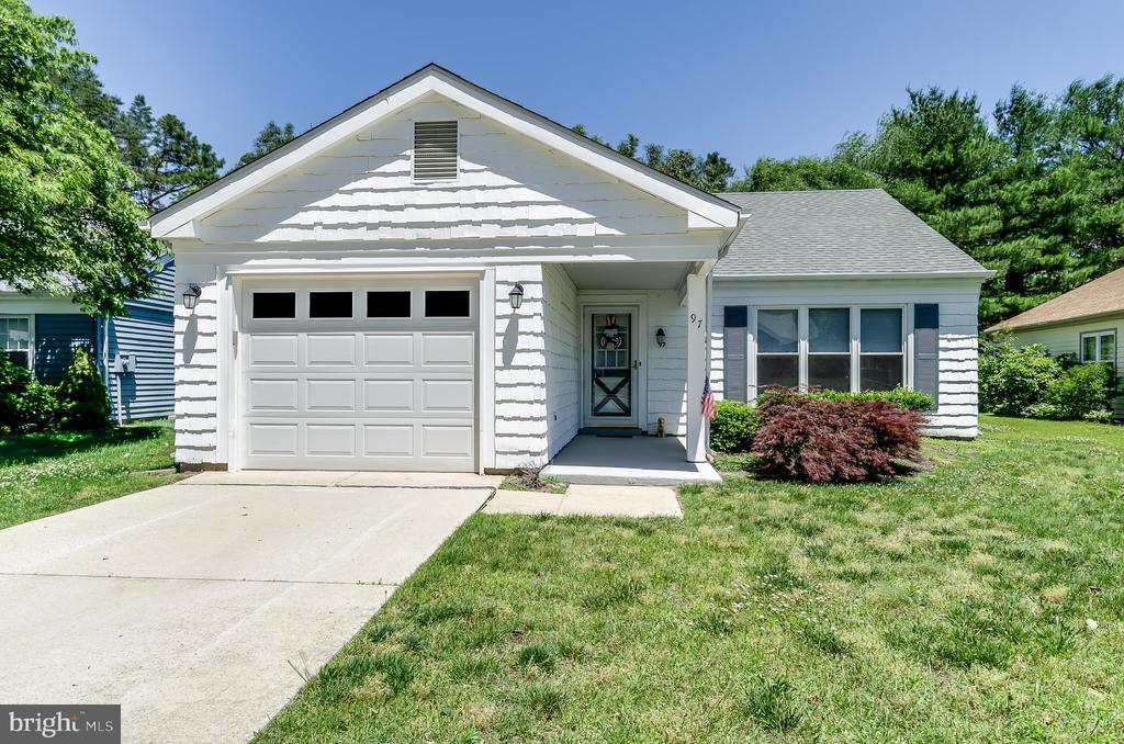 """You can't get much more newer than this!! Immaculate Expanded Danbury, completely renovated in 2018. New Roof w/attic fan, ridge vent; New HVAC system (13 SEER, 2-Ton Condenser/2-Ton Handler and 14 SEER, 2-Ton Heat Pump); New 200 Amp Electrical Panel and Breakers; New Garage Door/Assembly; New Hot Water Heater; New Laundry Room Area; New Windows; Stunning, newly renovated Guest and Master Bathrooms; New """"Hardscape"""" flooring in living room, dining room, bedrooms and halls; New Laminate in kitchen and family room; Kitchen absolutely gleams with shaker-style cabinets, granite countertop and Stainless Steel Appliance Package...again, all NEW. Heated addition/sunroom completely remodeled with new Soffits,Waterproof Vinyl Flooring; Master Bedroom has closet space galore with additional custom-built closet; Custom Levolor Cordless Cellular Window Treatments. New Ceiling Fans in Sun Room Addition and both Bedrooms. This home is worry-free from top to bottom. Owner purchased this immaculately renovated home in 2018 and put an additional $60k+ in additional renovations and appointments. A MUST SEE, MUST HAVE."""