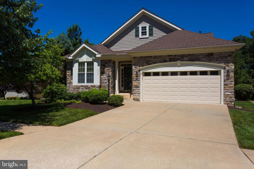 """NEW PRICE!  Beautiful move-in ready 2-level, 3-bed, 3-bath Danbury model in gated Heritage Hunt 55+ Golf community**Main-level master, laundry, main level 2nd bedroom** kitchen with new stainless appliances (2019), kitchen granite counters, 42"""" white cabinets**Vaulted ceilings**Sunroom leads to deck, concrete patio below**Lower level features large recreation/family room, bar, beautiful full bath, bonus room for possible game area, & unfinished space, deep storage closet**New carpets entire main level and stairs (2019), new paint throughout interior 2019, HVAC replaced 2013, newer roof in past 3-5 years**new light fixtures kitchen breakfast area, dining room, foyer, master bath, new light fixtures over garage, outside lamp post fixture and outside deck and patio**Come see and move right in.  Retractable awning conveys """"As Is."""" Free standing shelving units in garage and basement convey, metal work cabinet in garage conveys, 2 white cabinets in garage convey, 3 bar stools convey.  Buyer pays one time capital contribution fee of $3,660 at closing."""