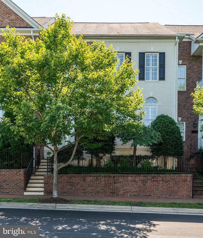 Exciting house, beautifully appointed and in pristine condition.  A quiet oasis of greenery surrounds this townhouse and its 3 balconies with privacy.   Located within walking distance of the Metro, shops and restaurants, this home offers a formal living room with furniture-grade built-ins, a gas fireplace and columns plus a large family room with a wall of windows.  3 BR, each with their own baths, walk-in closets with organizers and their own balconies.  A wonderful top floor terrace offers privacy and a wetbar with refrigerator close by. Custom plantation shutters throughout along with brand new carpeting in bedrooms and on stairs.  A 2-car garage with 2 large storage closets completes this special home.