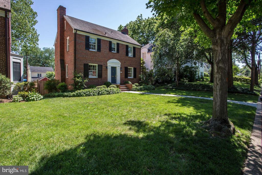 Beautiful center hall brick colonial on desired and convenient street near Spring Valley shopping area. Spacious living room with fireplace, dining room with built-ins, kitchen open to family room and overlooking landscaped rear garden and patio. Three bedrooms, two renovated baths on second level, sun-filled bedroom on top floor with huge walk-in closet. Finished lower level with den/office and recreation room, fifth bedroom with fireplace and full bath, laundry room with door to rear garden, detached one car garage. Private, fenced rear garden and patio. Beautiful, mature and professionally landscaped front and rear gardens.  Walk to Millie's, Starbucks, Pizzeria Paradiso, Wagshal's and Turtle Park. Open sun 6/16 from 2-4. Offers, if any, due Tuesday, 6/18 by 10AM. Pre-inspections welcome.