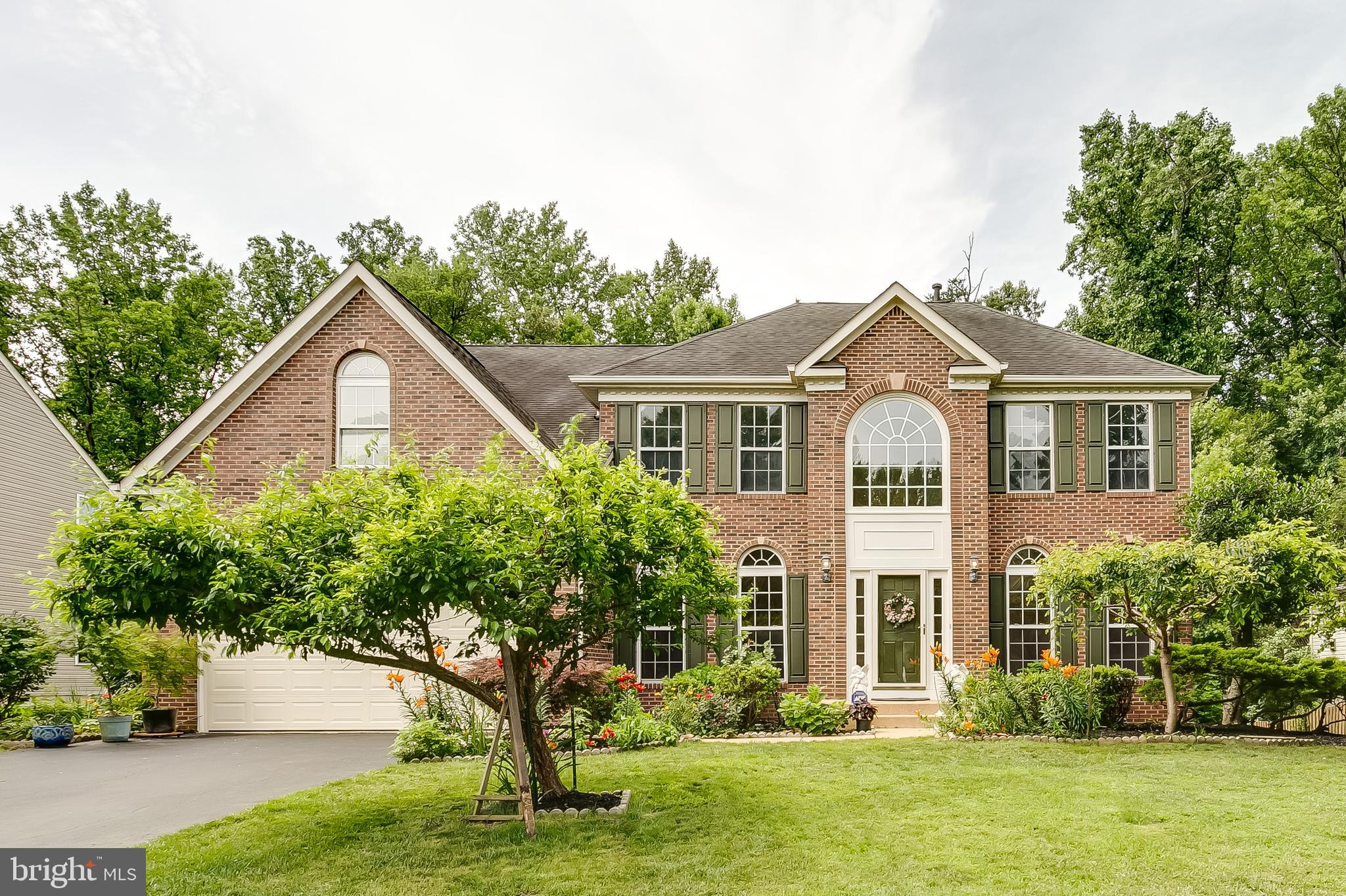 STUNNING HOME in the neighborhood, BRICK FRONT COLONIAL, 2-Story Foyer with OPEN FLOOR PLAN in a nice, quiet wooded neighborhood! LOCATION! LOCATION! LOCATION! Commuter's dream: few minutes to I-95, FX CO Prky, Metro Rail & Buses, walking distance to Fort Belvoir Military Base; Five minutes to shopping center, Wegman, gym fitness facility, hospital, parks, close to Kingstowne, ...; Den, Separate Formal Dining, Living room ML  with CROW MOLDINGS; GOURMET KITCHEN with New SS Appliances; MANY RECENT UPGRADES; New insulated steel/fiberglass garage doors with remotes; OAK DUAL STAIRCASE with Runners! HARDWOOD FLOORS, NEW CARPET, FRESH DESIGNER PAINT for ALL LEVELS;... MASTER BEDROOM with HIS&HER HUGE WALK-IN CLOSET; NICE SUNROOM ADDITION viewing mature flowers, trees (Japanese maple, maple, cherry, redbud trees, etc); LOVELY DECK overlooking GORGEOUS LARGE FLAT BACKYARD with the wooded area! WALK OUT BASEMENT with SPACIOUS REC ROOM