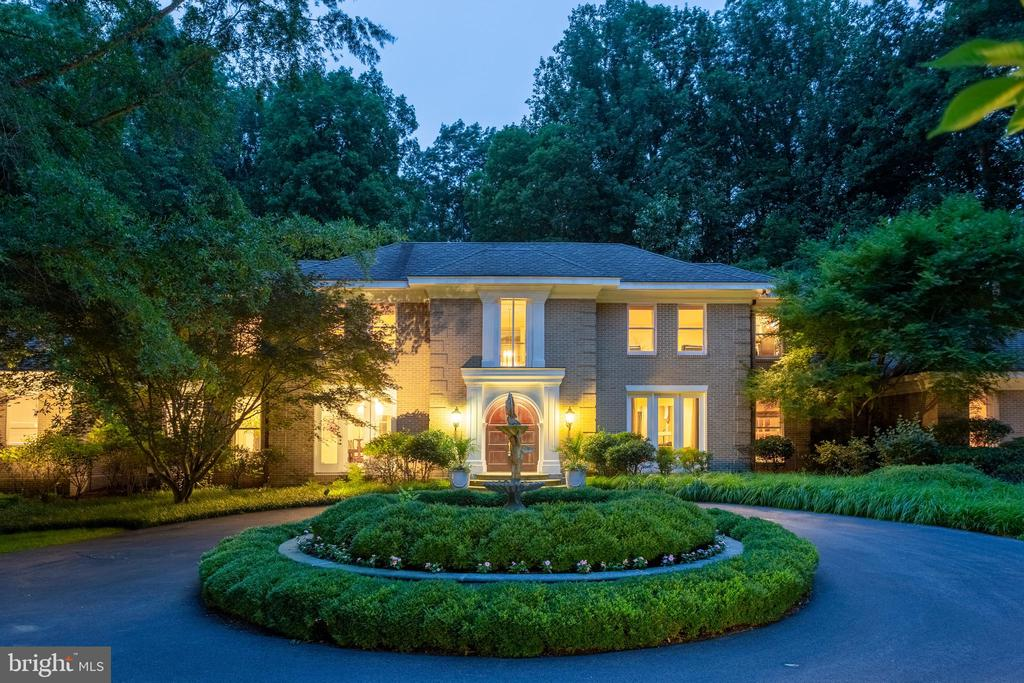 Glorious abode, stretches across a crested hill behind a sparkling fountain & a charming garden wall with inviting soiree steps. It stretches across the hill-crest with wing after wing encasing room after room with 7,600+ sqft ultimate luxury. *Roof was replaced in 2014, HVAC 2016, 2 water heaters in 2018 & generator in 2016* The foyer has twin Charleston style staircases that rise to an upper gallery. The formal rooms feature intricate trim work. The family room overlooks a grand portico, resort style swimming pool, waterfall, & a cabana pavilion. The kitchen opens to a morning room wrapped in glass that overlooks the serenity gardens set within a private courtyard. The library offers inspirational views of the patio and surroundings. The main level master suite is out-shadowed by the 2nd floor master suite. Both offer world-class ultra -luxurious bathrooms & fireplaces. Each bedroom has a luxury bath en-suite. Plus the club level offers a huge club room painted in magnificent safari frescos & club style lighting showcasing the gallery niches and trophy cases. The garage wing can store up to 6 cars. **The Seller will paint any or all  of the personalized faux painting in the house in the Buyer~s choice of color - The Basement furniture and/or the painting in the Foyer at the top of the stairwell will convey with the house, should the buyer not want the foyer walls and/or basement walls repainted!!!!!**